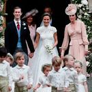 Pippa Middleton and James Matthews smile as they are joined by Catherine, Duchess of Cambridge, right, after their wedding at St Mark's Church onMay 20, 2017 in Englefield, England.