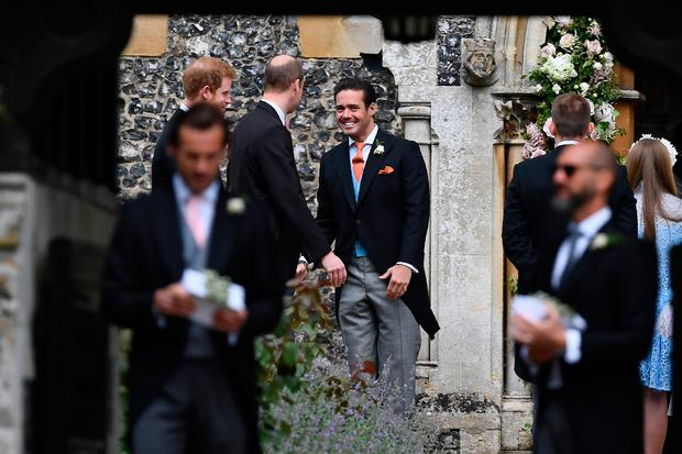 Spencer Matthews, brother of the groom, greets Britain's Princes William and Harry outside the church ahead of the wedding of Pippa Middleton and James Matthews at St Mark's Church in Englefield