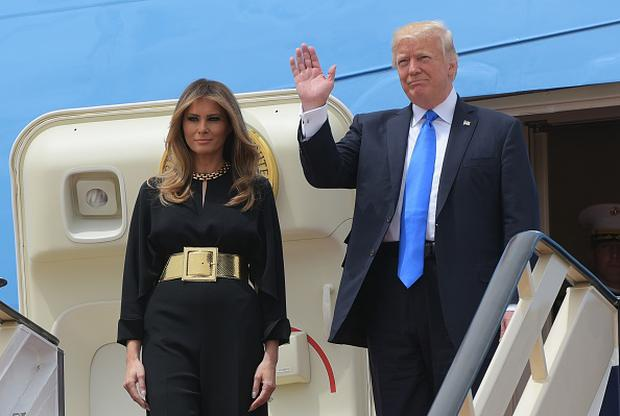 US President Donald Trump and First Lady Melania Trump step off Air Force One upon arrival at King Khalid International Airport in Riyadh on May 20, 2017. / AFP PHOTO / MANDEL NGAN (Photo credit: MANDEL NGAN/AFP/Getty Images)