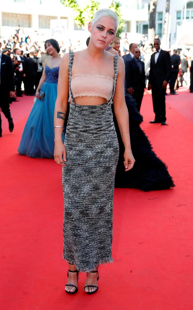 Director and actress Kristen Stewart poses in Chanel at the 70th Cannes Film Festival