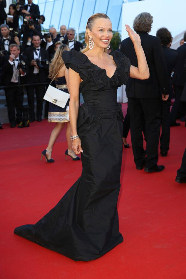 Model Pamela Anderson poses for photographers upon arrival at the screening of the film 120 Beats Per Minute at the 70th international film festival, Cannes, southern France, Saturday, May 20, 2017. (AP Photo/Alastair Grant)