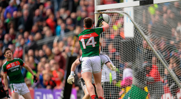 21 May 2017; Cillian O'Connor of Mayo scores his side's second goal past Sligo goalkeeper Aidan Devaney during the Connacht GAA Football Senior Championship Quarter-Final match between Mayo and Sligo at Elvery's MacHale Park in Castlebar, Co. Mayo. Photo by Stephen McCarthy/Sportsfile