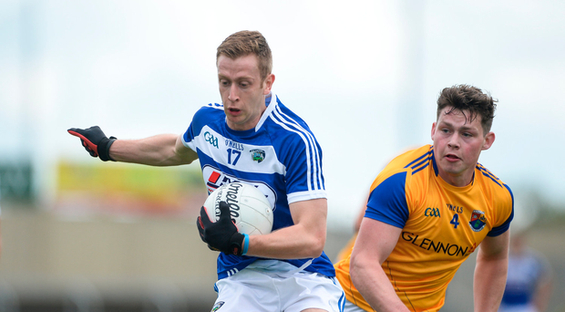 21 May 2017; Paul Kingston of Laois in action against Andrew Farrell of Longford during the Leinster GAA Football Senior Championship Round 1 match between Laois and Longford at O'Moore Park in Portlaoise, Co Laois. Photo by Daire Brennan/Sportsfile