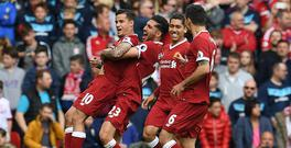 Liverpool's Brazilian midfielder Philippe Coutinho (L) celebrates scoring his team's second goal during the English Premier League football match between Liverpool and Middlesbrough at Anfield in Liverpool, north west England on May 21, 2017. / AFP PHOTO / Paul ELLIS /