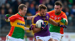 21 May 2017; Brian Malone of Wexford in action against Danny Moran, left, and Eoghan Ruth of Carlow during the Leinster GAA Football Senior Championship Round 1 match between Carlow and Wexford at Netwatch Cullen Park in Carlow. Photo by Ramsey Cardy/Sportsfile