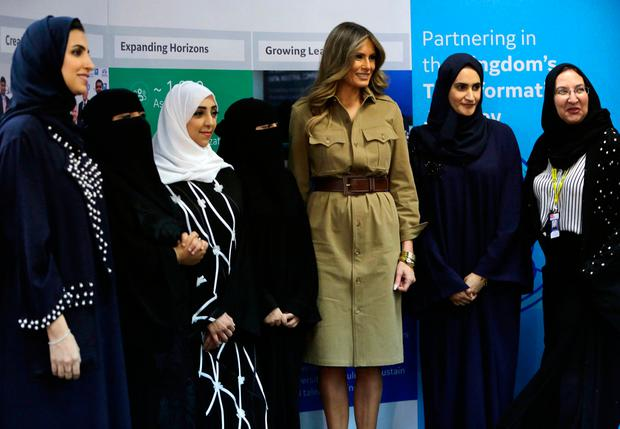U.S. First Lady Melania Trump poses for a photo with Saudi women on a visit to an all-women's business services center in Riyadh, Saudi Arabia, Sunday, May 21, 2017. General Electric and Saudi Aramco are key partners in the center, which provides career opportunities for well-educated Saudi women. (AP Photo/Hasan Jamali)