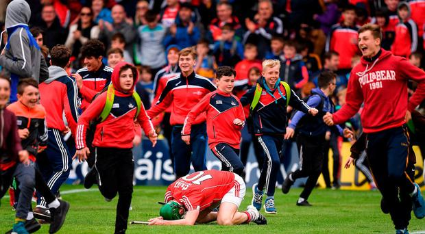 Seamus Harnedy of Cork falls to his knees as Cork supporters rush to celebrate victory, over Tipperary, after the Munster GAA Hurling Senior Championship Semi-Final match between Tipperary and Cork at Semple Stadium in Thurles, Co Tipperary. Photo by Ray McManus/Sportsfile