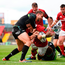 Francis Saili goes over for Munster's first try despite the best efforts of Ospreys' Ashley Beck. Photo by Brendan Moran/Sportsfile