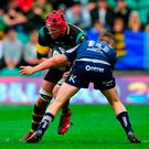 Christian Day of Northampton Saints is tackled by Jack Carty of Connacht. Photo by Tony Marshall/Getty Images