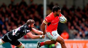 Saracens' Billy Vunipola (right) gets away from Exeter Chief's Geoff Parling during the Aviva Premiership Semi final match at Sandy Park yesterday