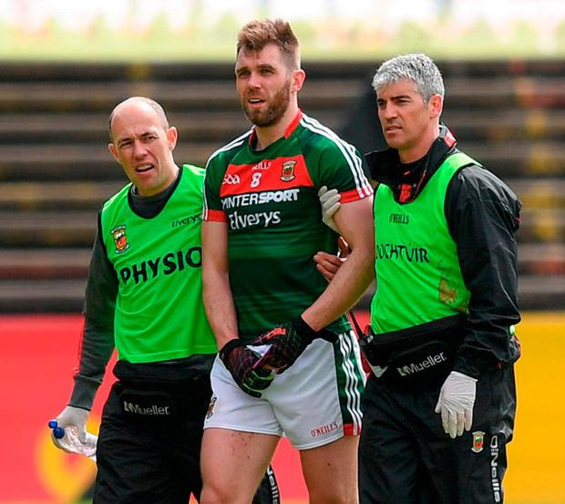 Mayo's Seamus O'Shea leaves the pitch after picking up an injury. Photo: Stephen McCarthy/Sportsfile