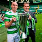 Scott Brown and Brendan Rodgers with the Scottish Premiership trophy after Celtic's 2-0 victory over Hearts at Parkhead yesterday. Photo credit: Craig Watson/PA Wire