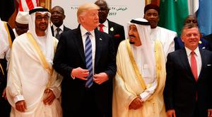 President Donald Trump talks with Saudi King Salman as they pose for photos with leaders at the Arab Islamic American Summit, at the King Abdulaziz Conference Center in Riyadh, Saudi Arabia. Photo: AP
