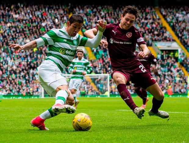 Celtic's Cristian Gamboa (left) and Heart of Midlothian's Liam Smith battle for the ball. Photo credit: Craig Watson/PA Wire