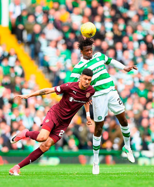 Heart of Midlothian's Bjorn Johnsen (left) and Celtic's Dedryck Boyata battle for the ball. Photo credit: Craig Watson/PA Wire