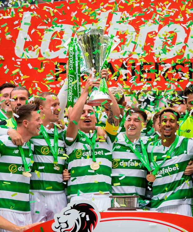 Celtic's Scott Brown lifts the trophy. Photo credit: Craig Watson/PA Wire