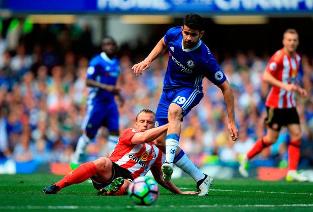 Chelsea's Diego Costa (right) and Sunderland's Cattermole. Photo credit: Mike Egerton/PA Wire
