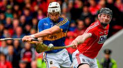 Cork's Damian Cahalane stretches to block Brendan Maher's effort for Tipperary during yesterday's Munster SHC quarter-final in Thurles. Photo: Ray McManus/Sportsfile