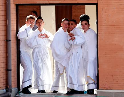 Altar boys wait to see Pope Francis at Casal Bernocchi on the southern outskirts of Rome. REUTERS/Remo Casilli
