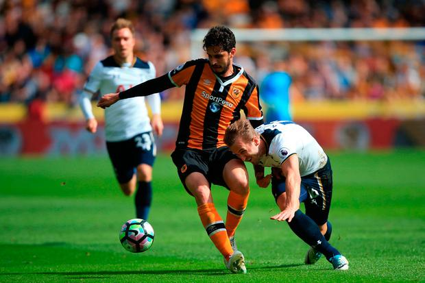 Tottenham Hotspur's Harry Kane (right) and Hull City's Andrea Ranocchia battle for the ball. Photo credit: Danny Lawson/PA Wire