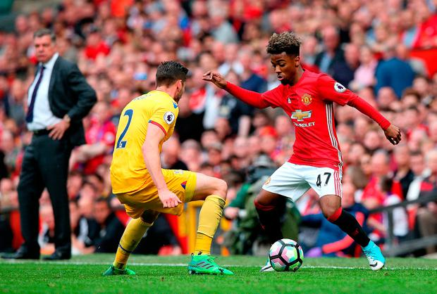 Manchester United's Angel Gomes (right) in action. Photo credit: Martin Rickett/PA Wire