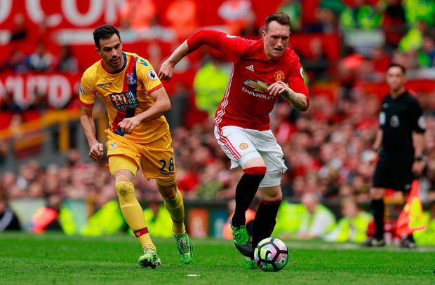 Crystal Palace's Luka Milivojevic in action with Manchester United's Phil Jones. Photo: Reuters / Jason Cairnduff