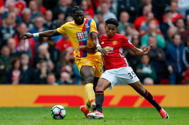 Manchester United's Demetri Mitchell in action with Crystal Palace's Bakary Sako. Photo: Reuters / Andrew Yates