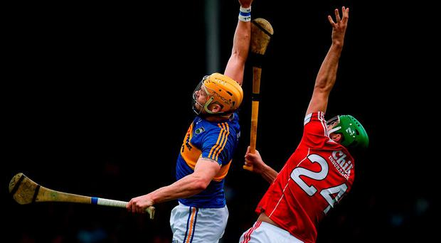 Cork's Michael Cahalane and Tipperary's Padraic Maher rise for a high ball. Photo: Ray McManus/Sportsfile