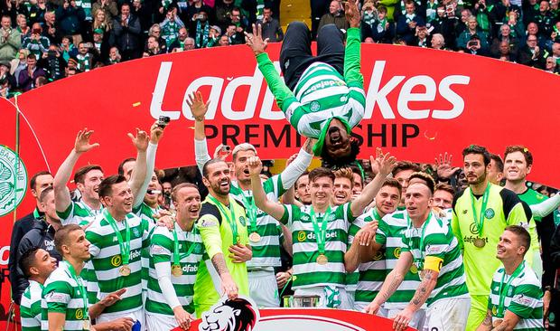 Celtic's Effe Ambrose backflips after his side lifted the Scottish Premiership trophy at Celtic Park yesterday. Photo: PA