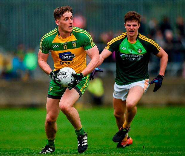 Donegal's Hughie McFadden in action against Antrim's Conor Hamill. Photo: Philip Fitzpatrick/Sportsfile