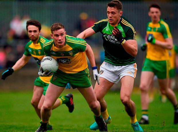Donegal's Ciaran Thompson in action against Antrim's Mark Sweeney. Photo: Philip Fitzpatrick/Sportsfile