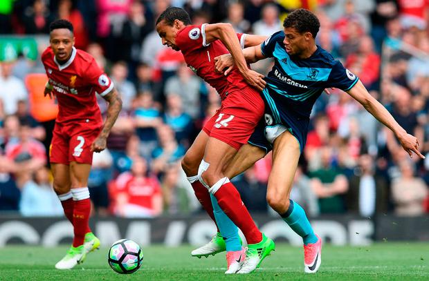 Liverpool's German-born Cameroonian defender Joel Matip (C) vies with Middlesbrough's French striker Rudy Gestede. Photo: Getty Images