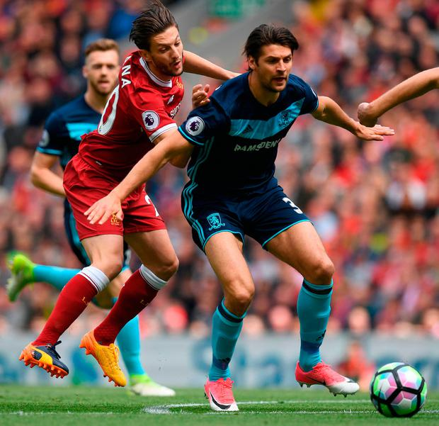 Liverpool's English midfielder Adam Lallana (L) vies with Middlesbrough's English defender George Friend. Photo: Getty Images