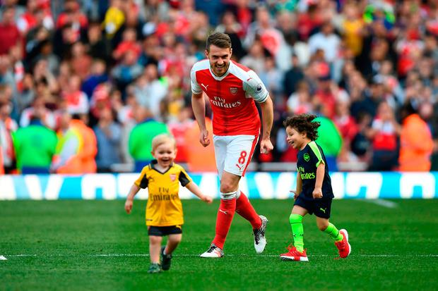 Arsenal's Welsh midfielder Aaron Ramsey (C) plays on the pitch. Photo: Getty Images