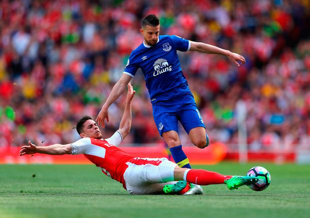Gabriel of Arsenal tackles Kevin Mirallas of Everton. Photo by Clive Mason/Getty Images