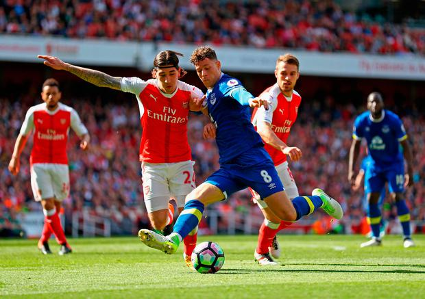Ross Barkley of Everton and Hector Bellerin of Arsenal clash. Photo by Paul Gilham/Getty Images