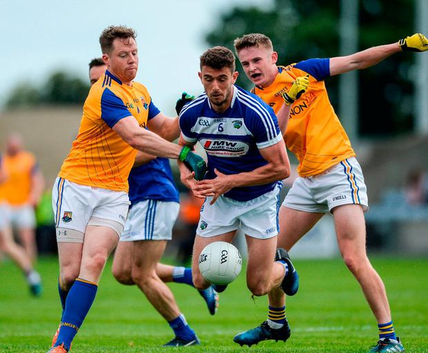 Laois' Colm Begley in action against Longford's Seán McCormack, left, and Des Reynolds. Photo: Daire Brennan/Sportsfile