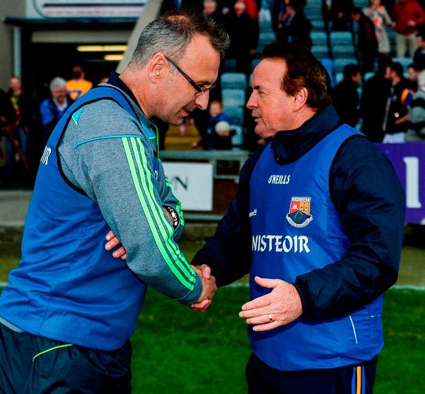 Laois manager Peter Creedon shakes hands with Longford manager Denis Connerton. Photo: Daire Brennan/Sportsfile