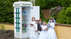 Lily Murphy, Mia Kenny, Sam Walsh, Chloe O'Neill and Jessica Sheehan at the library kiosk in Knockananna, Co Wicklow. Picture: Michael Kelly