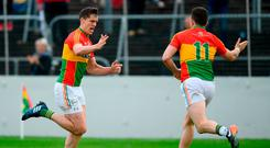 Carlow's Brendan Murphy celebrates with Darragh Foley after scoring his side's second goal. Photo: Ramsey Cardy/Sportsfile