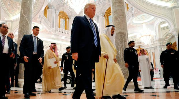 U.S. President Donald Trump walks with Saudi Arabia's King Salman bin Abdulaziz Al Saud to deliver a speech to the Arab Islamic American Summit in Riyadh, Saudi Arabia. Photo: REUTERS/Jonathan Ernst
