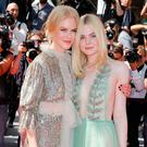 Nicole Kidman and Elle Fanning walk the red carpet at Cannes Photo: Getty