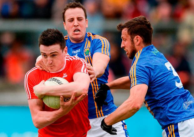 Louth's Tommy Durnin in action against Wicklow's Paul McLoughlin and Stephen Kelly. Photo: Piaras Ó Mídheach/Sportsfile