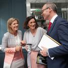 Fine Gael TDs Maria Bailey and Kate O'Connell with Simon Coveney at the launch of his policy document in the Dean Hotel in Dublin yesterday. Photo: Gareth Chaney