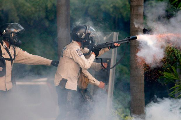 Government security forces launch tear gas at protesters during clashes in Caracas, Venezuela, Saturday, May 20, 2017. (AP Photo/Ariana Cubillos)