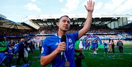 Chelsea's John Terry gestures as he gives a speech on the pitch after winning the Premier League