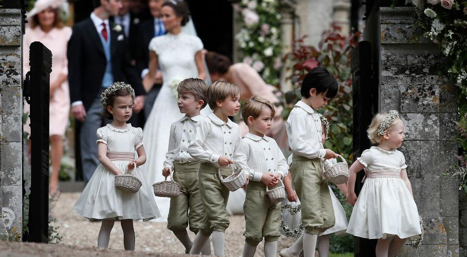 ENGLEFIELD, ENGLAND - MAY 20: Prince George, fourth left, stands with other flower boys and girls after the wedding of Pippa Middleton and James Matthews at St Mark's Church onMay 20, 2017 in Englefield, England.Middleton, the sister of Catherine, Duchess of Cambridge married hedge fund manager James Matthews in a ceremony Saturday where her niece and nephew Prince George and Princess Charlotte was in the wedding party, along with sister Kate and princes Harry and William. (Photo by Kirsty Wigglesworth - Pool/Getty Images)