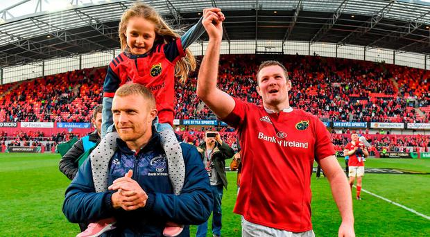 Keith Earls, left, and his daughter Ella May with Donnacha Ryan of Munster after the Guinness PRO12 semi-final match between Munster and Ospreys at Thomond Park in Limerick. Photo by Brendan Moran/Sportsfile