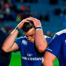 Leinster players, from left, Hayden Triggs, Robbie Henshaw and Ross Molony appear dejected after the defeat to the Scarlets