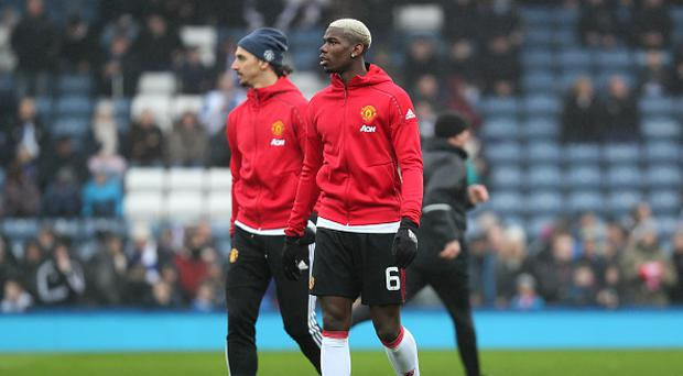 BLACKBURN, ENGLAND - FEBRUARY 19: Zlatan Ibrahimovic and Paul Pogba of Manchester United (R) warm up prior to the Emirates FA Cup Fifth Round match between Blackburn Rovers and Manchester United at Ewood Park on February 19, 2017 in Blackburn, England. (Photo by Matthew Ashton - AMA/Getty Images)